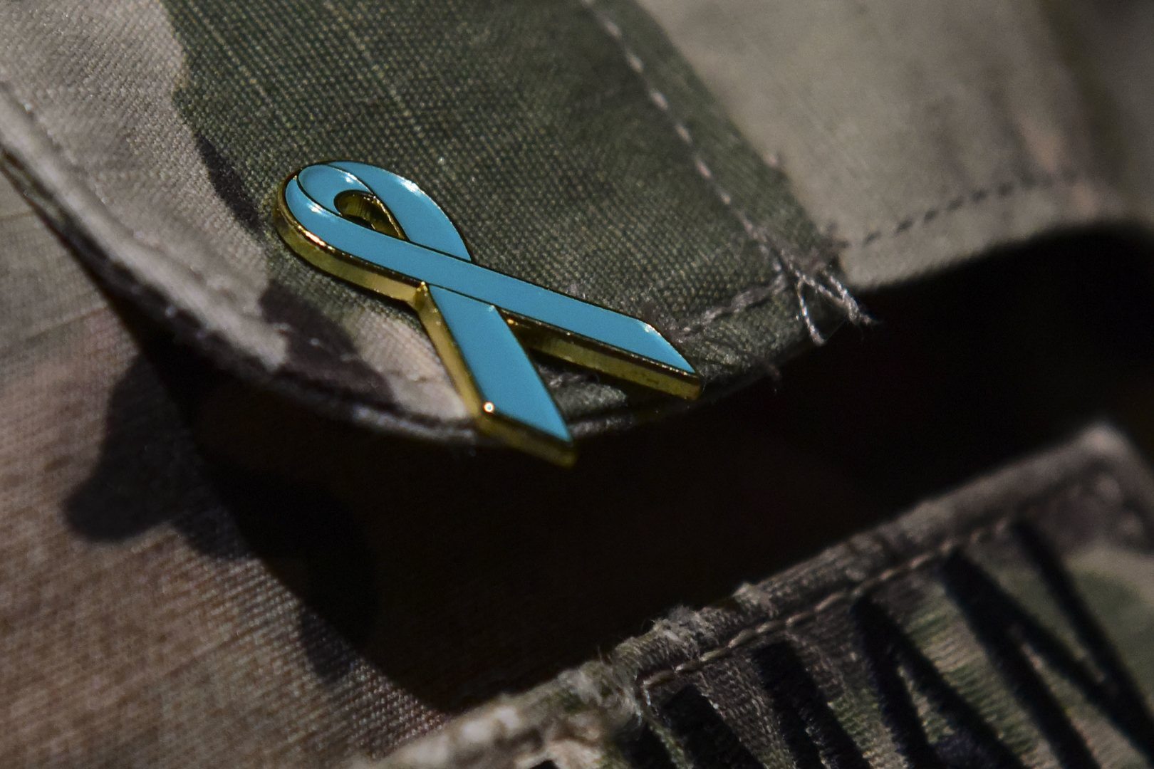 A Sexual Harassment/Assault Response and Prevention Program pin is worn by a U.S. Army Soldier at Joint Base Langley-Eustis, Virginia, April 25, 2018. The SHARP team members aimed to provide a more lighthearted environment for Soldiers to engage in a discussion about sexual assault prevention. (U.S. Air Force photo by Airman 1st Class Monica Roybal)