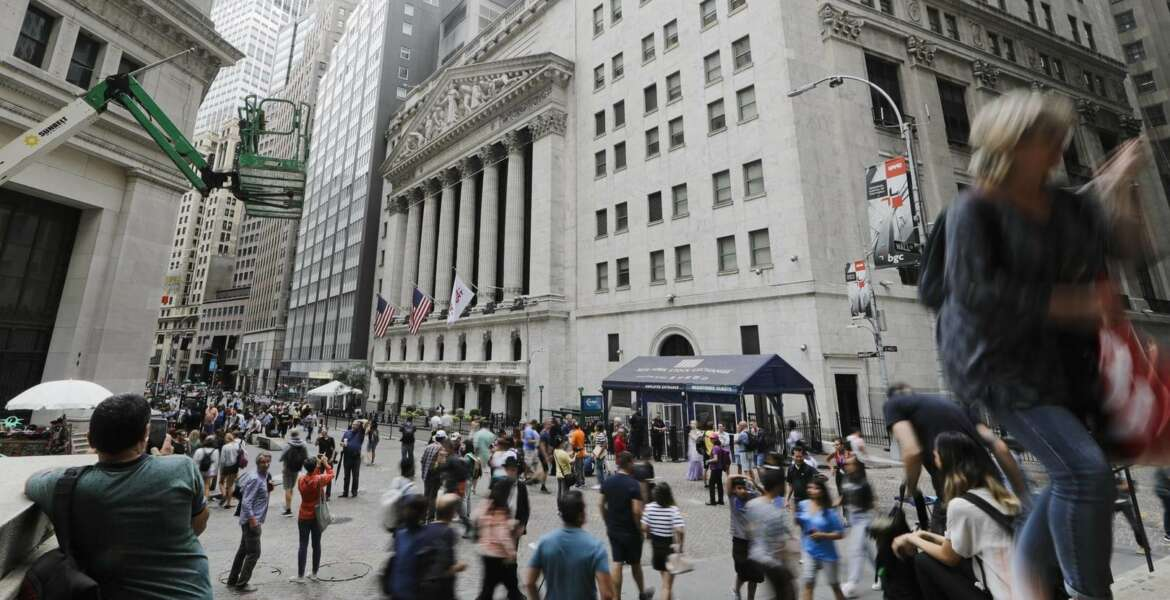Pedestrians pass the New York Stock Exchange Friday, Aug. 23, 2019 in New York. Stocks fell sharply on Wall Street Friday after President Donald Trump called on U.S. companies to consider alternatives to doing business in China.(AP Photo/Frank Franklin II)