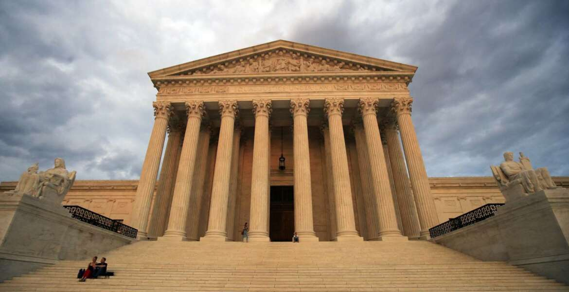 """FILE - In this Oct. 18, 2018 file photo, the U.S. Supreme Court is seen at near sunset in Washington. Dozens of legal briefs supporting fired funeral director Aimee Stephens at the Supreme Court use """"she"""" and """"her"""" to refer to the transgender woman. So does the appeals court ruling in favor of Stephens that held that workplace discrimination against transgender people is illegal under federal civil rights law. But in more than 110 pages urging the Supreme Court to reverse that decision, the Trump administration and the funeral home where Stephens worked avoid those gender pronouns. (AP Photo/Manuel Balce Ceneta, File)"""