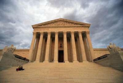 "FILE - In this Oct. 18, 2018 file photo, the U.S. Supreme Court is seen at near sunset in Washington. Dozens of legal briefs supporting fired funeral director Aimee Stephens at the Supreme Court use ""she"" and ""her"" to refer to the transgender woman. So does the appeals court ruling in favor of Stephens that held that workplace discrimination against transgender people is illegal under federal civil rights law. But in more than 110 pages urging the Supreme Court to reverse that decision, the Trump administration and the funeral home where Stephens worked avoid those gender pronouns. (AP Photo/Manuel Balce Ceneta, File)"
