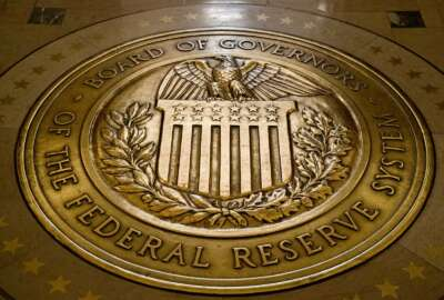 FILE- In this Feb. 5, 2018, file photo, the seal of the Board of Governors of the United States Federal Reserve System is displayed in the ground at the Marriner S. Eccles Federal Reserve Board Building in Washington. On Thursday, Sept. 12, 2019, the Senate confirmed President Donald Trump's nomination of Michelle Bowman to serve a full 14-year term on the seven-member Federal Reserve board. (AP Photo/Andrew Harnik, File)