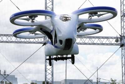 NEC Corp.'s machine with propellers hovers at the company's facility in Abiko near Tokyo, Monday, Aug. 5, 2019. The Japanese electronics maker showed a