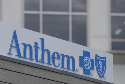 FILE - In this May 14, 2019, file photo signage on the outside of the corporate headquarters building of health insurance company Anthem is shown in Indianapolis. Anthem Inc. reports financial earns on Wednesday, Oct. 23. (AP Photo/Michael Conroy, File)