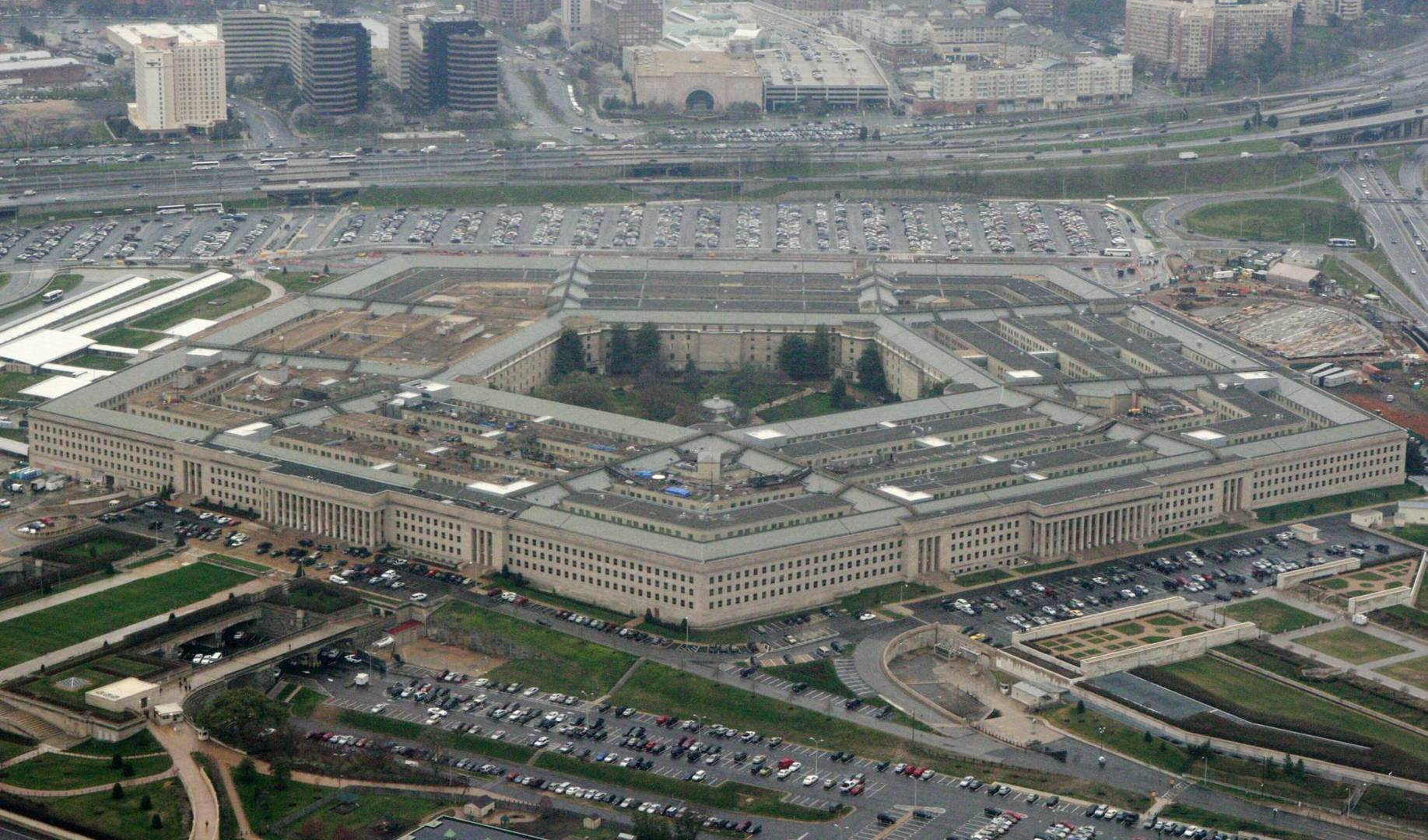 "FILE - This March 27, 2008, aerial file photo, shows the Pentagon in Washington. Amazon is protesting the Pentagon's decision to award a huge cloud-computing contract to Microsoft, citing ""unmistakable bias"" in the decision. Amazon's competitive bid for the ""war cloud"" drew criticism from President Donald Trump and its business rivals. ((AP Photo/Charles Dharapak, File)"