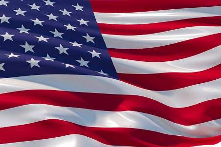 Fluttering silk flag of United States of America. Old Glory in the wind, colorful background