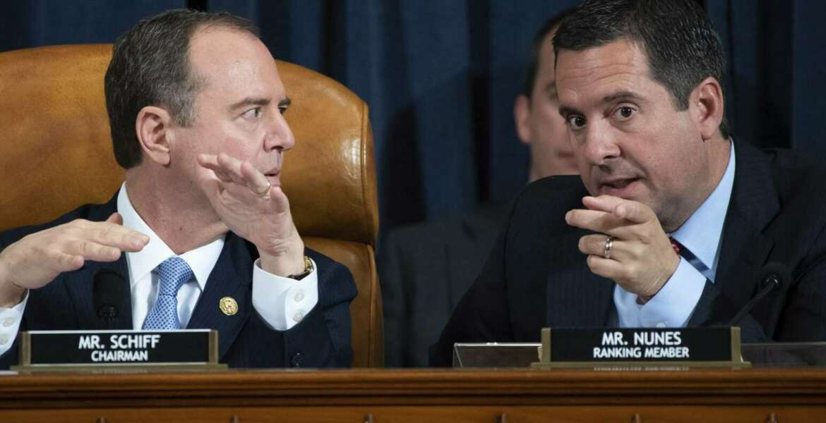 House Intelligence Committee Chairman Rep. Adam Schiff, D-Calif., left, talks with ranking member Rep. Devin Nunes, R-Calif., during a hearing of the House Intelligence Committee on Capitol Hill in Washington, Wednesday, Nov. 13, 2019, during the first public impeachment hearing of President Donald Trump's efforts to tie U.S. aid for Ukraine to investigations of his political opponents. (Saul Loeb/Pool Photo via AP)