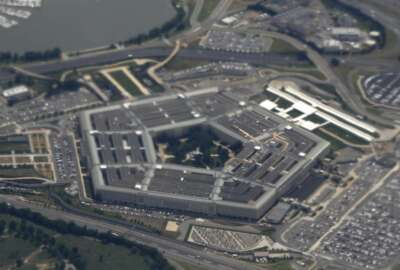 FILE - In this June 3, 2011, file photo, the Pentagon is seen from air from Air Force One. The House has passed its annual defense policy measure, which combines a $738 billion Pentagon price tag with legislation to provide federal employees with 12 weeks of paid parental leave. (AP Photo/Charles Dharapak, File)