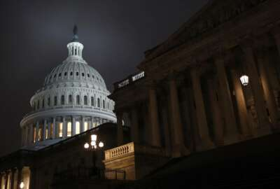 """Light shines on the U.S. Capitol dome early Monday, Dec. 9, 2019, on Capitol Hill in Washington. The White House endorsed an emerging bipartisan agreement Monday on legislation aimed at curbing rising health care costs, including taking steps to limit """"surprise"""" medical bills that can plague patients treated in emergency rooms. (AP Photo/Patrick Semansky)"""
