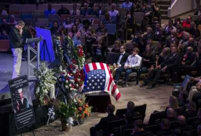 Hunter Cannon, left, speaks during the funeral service for his best friend U.S. Navy Airmen Apprentice Cameron Walters at the Compassion Christian Church in Savannah, Ga., Monday, Dec. 16, 2019. Walters was one of three Navy sailors killed in a Saudi gunman's attack at Naval Air Station Pensacola in Florida on Dec. 6. (Stephen B. Morton/Atlanta Journal-Constitution via AP)