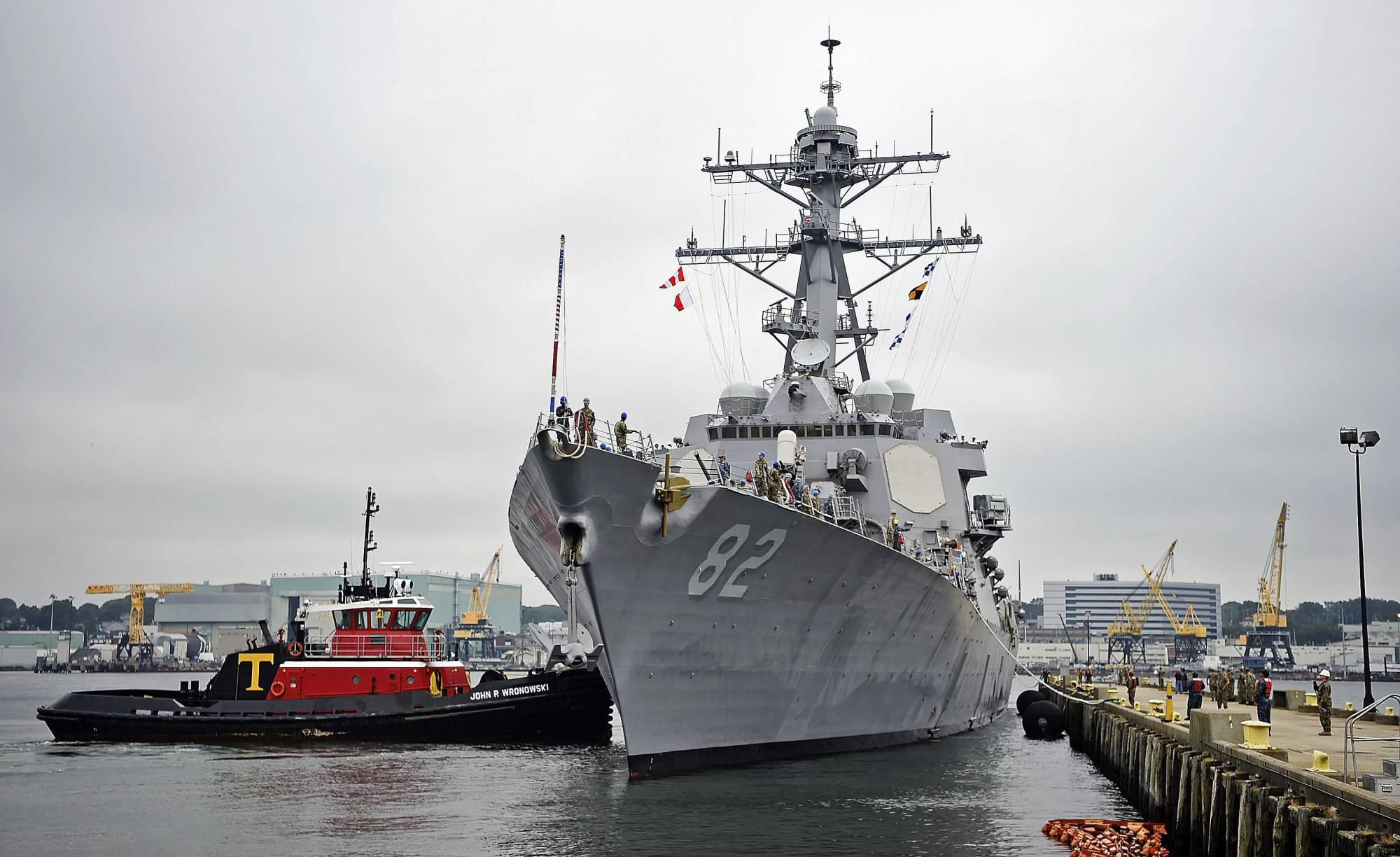 FILE - In this Sept. 6, 2019 file photo, the U.S. Navy Arleigh Burke-class guided missile destroyer USS Lassen (DDG-82) moors at Fort Trumbull State Park in New London, Conn.  The Navy is proposing construction cutbacks and accelerated ship retirements that would delay, or sink, the Navy's goal of a larger fleet — and potentially hurt shipyards, according to an initial proposal.    The proposal would shrink the size of the fleet from today's level of 293 ships to 287 ships, a far cry from the official goal of 355 ships established in the 2018 National Defense Authorization Act.  (Sean D. Elliot/The Day via AP, File)