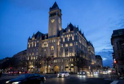 FILE - In this Jan. 23, 2019, file photo, the Trump International Hotel near sunset in Washington. A federal appeals court is set to rehear arguments Thursday, Dec. 12, in a lawsuit that accuses President Donald Trump of illegally profiting off the presidency through his luxury Washington hotel. (AP Photo/Alex Brandon, File)