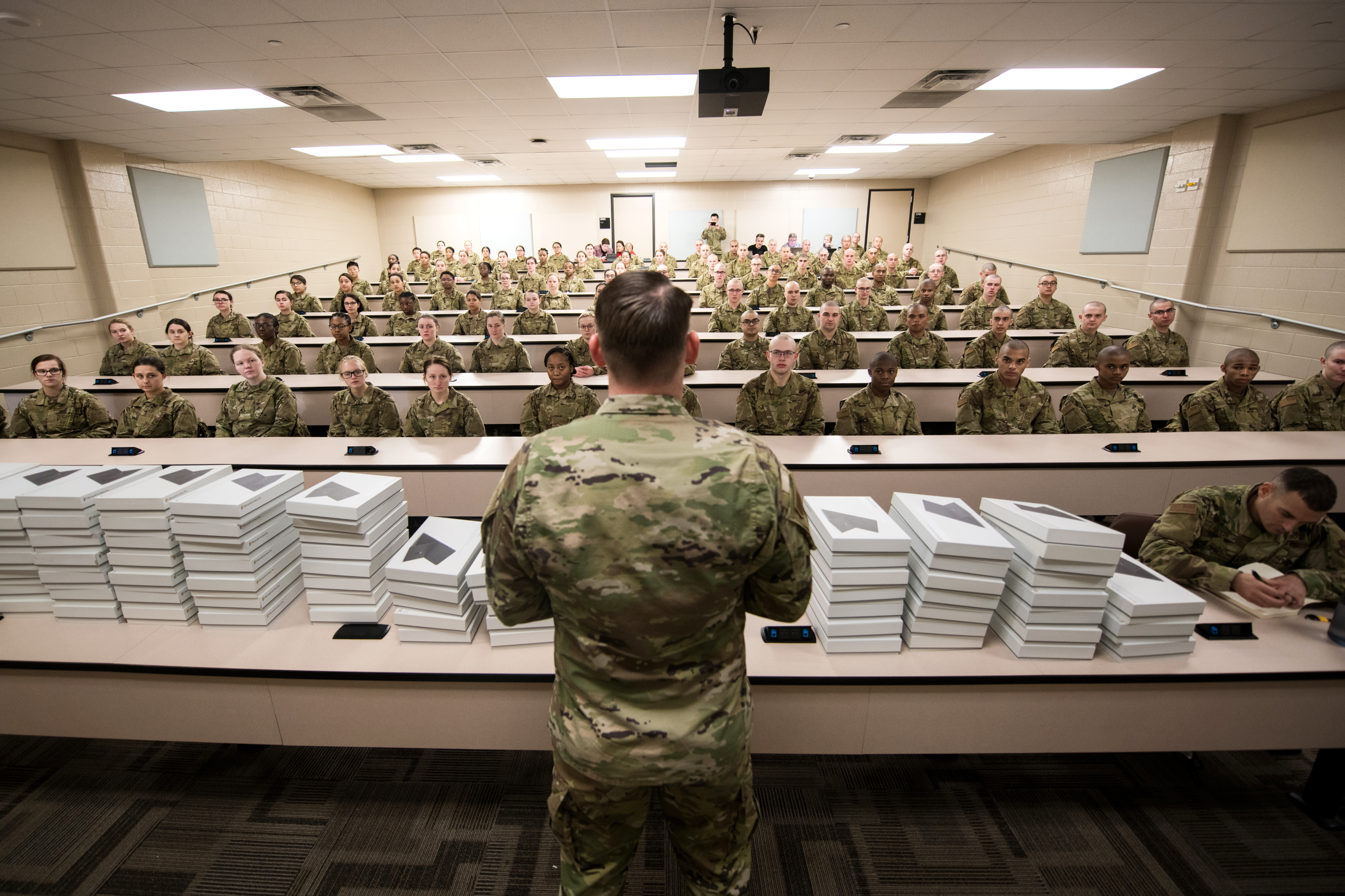 U.S. Air Force basic military training trainees are issued  personal computers during in-processing as part of a pilot test under a  Cooperative Research and Development Agreement partnership at Joint Base San  Antonio-Lackland, Texas, Dec. 11, 2019. The computers replace all hard copy  textbooks BMT trainees currently use with the intent to help BMT assess  learning outcomes, value and return on investment. (U.S. Air Force photo by Sarayuth Pinthong)