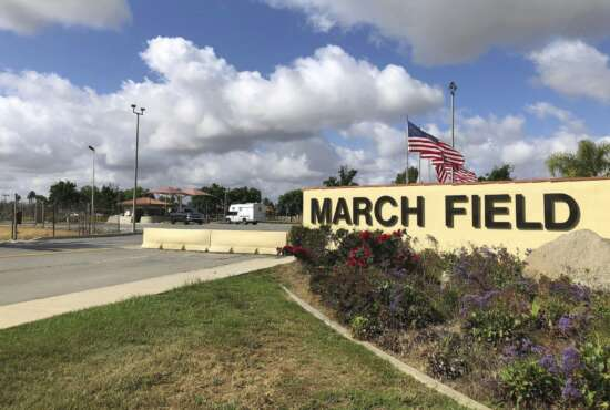 FILE - This Friday, March 17, 2019 file photo shows the main entrance to March Air Reserve Base in Riverside, Calif.  Nearly 200 Americans evacuated from China because of the new virus are