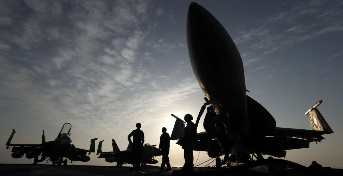 FILE- In this Nov. 22, 2016 file photo, U.S. Navy sailors stand by fighter jets on the deck of the U.S.S. Dwight D. Eisenhower in the Persian Gulf. The United States' Gulf allies have pushed for hawkish policies by Washington to pressure, isolate and cripple Iran, but this high-stakes strategy is now being put to the test by the surprise U.S. killing of Iran's most powerful military commander. The killing appears to have caught America's Gulf allies off-guard and threatens to draw Gulf states further into the cross-hairs of rising tensions between Washington and Tehran. (AP Photo/Petr David Josek, File)