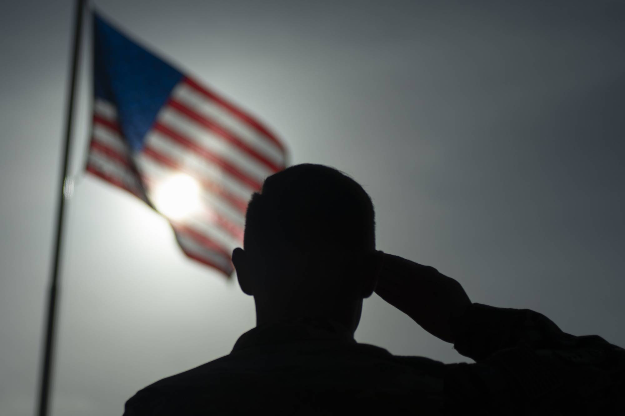 In this photo taken Aug. 26, 2019 and released by the U.S. Air Force, U.S. Air Force Staff Sgt. Devin Boyer, 435th Air Expeditionary Wing photojournalist, salutes the flag during a ceremony signifying the change from tactical to enduring operations at Camp Simba, Manda Bay, Kenya. The al-Shabab extremist group said Sunday, Jan. 5, 2020 that it has attacked the Camp Simba military base used by U.S. and Kenyan troops in coastal Kenya, while Kenya's military says the attempted pre-dawn breach was repulsed and at least four attackers were killed. (Staff Sgt. Lexie West/U.S. Air Force via AP)