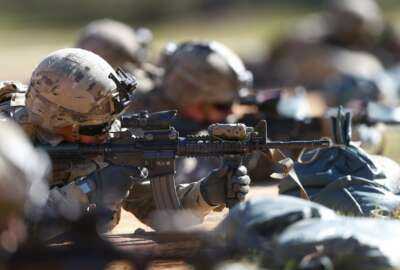 FILE - In this Oct. 17, 2017, file photo, U.S. Army soldiers hone their long-distance marksmanship skills as they train at Fort Benning in Columbus, Ga. The soldiers are members of the Army's new Security Force Assistance Brigade. The Army, for the first time, will send soldiers from one of it's new training brigades to Africa in the coming weeks, expanding the use of the new specialized units as the Pentagon looks at possible troop cuts on the continent. (AP Photo/John Bazemore, File)