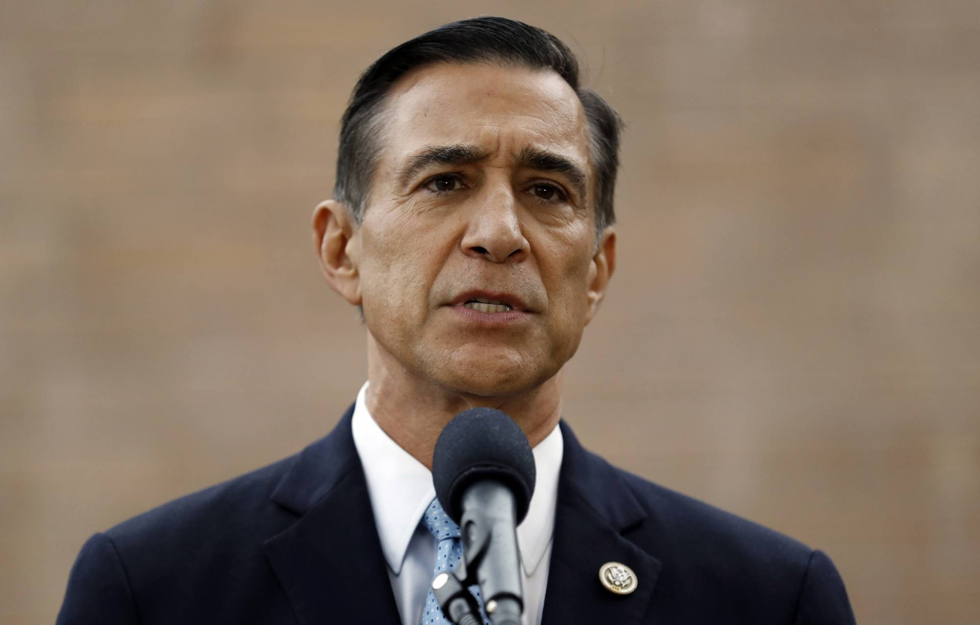 FILE - In this Sept. 26, 2019 file photo, former Republican congressman Darrell Issa speaks during a news conference in El Cajon, Calif. The race to fill the vacated seat of former Republican U.S. Rep. Duncan Hunter of Californiahas turned into a GOP slugfest. Hunter held one of the party's few remaining House seats in California before he pleaded guilty to a corruption charge and resigned last month. The race to replace him has been especially bitter between the Republican front-runners, former congressman Issa and San Diego radio host and political commentator Carl DeMaio. (AP Photo/Gregory Bull, File)