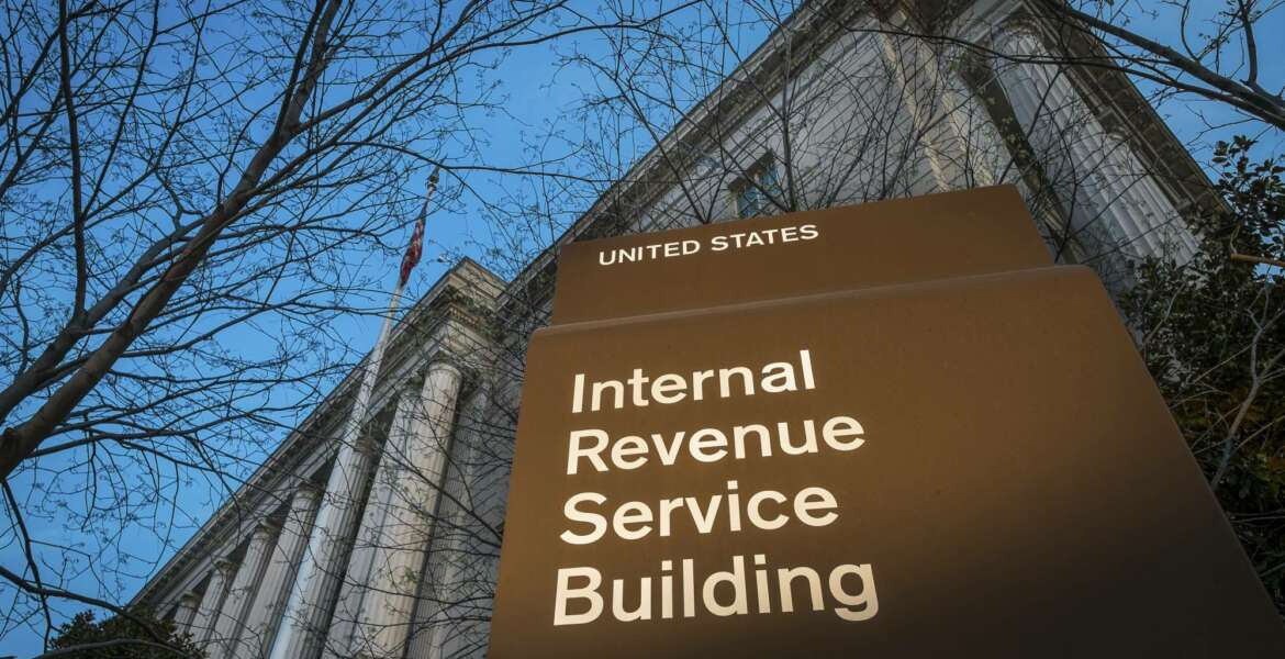 FILE - This April 13, 2014 file photo shows the headquarters of the Internal Revenue Service (IRS) in Washington. The agency said Wednesday, Feb. 19, 2020, that it is stepping up its efforts to visit high-income taxpayers who failed in prior years to file their tax returns on time. (AP Photo/J. David Ake, File)