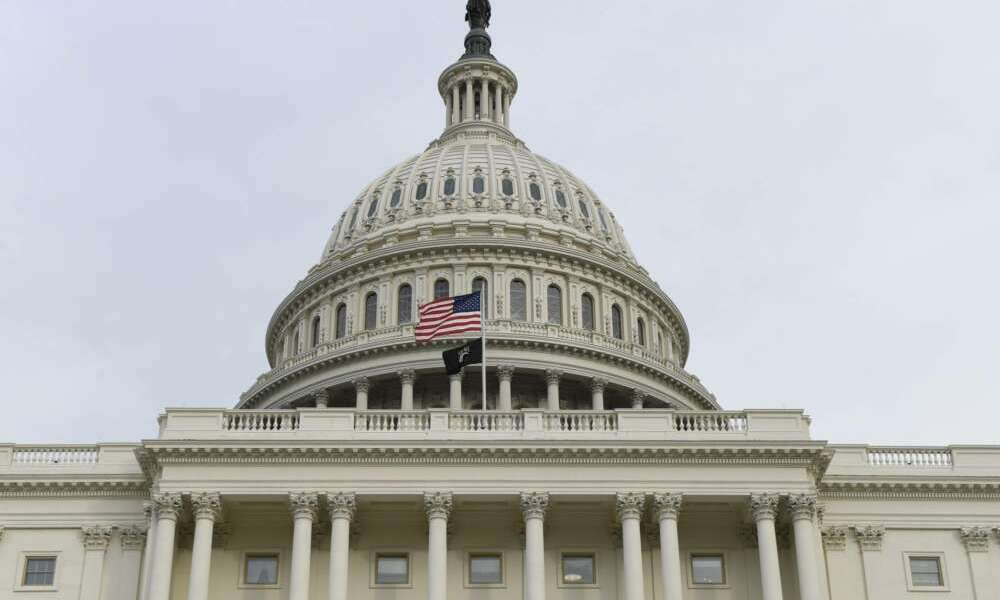 The flag flies outside the U.S. Capitol ahead of President Donald Trump delivering his State of the Union address to a joint session of Congress on Capitol Hill in Washington, Tuesday, Feb. 4, 2020. (AP Photo/Susan Walsh)
