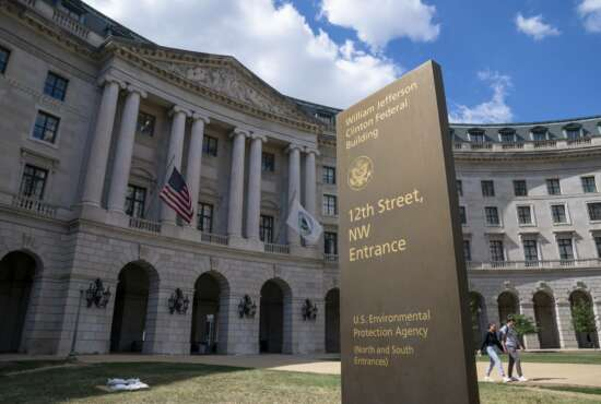 FILE - In this Spet. 18, 2019, file photo, the headquarters of the Environmental Protection Agency in Washington. A Trump administration proposal to roll back environmental reviews for big projects is drawing heavy objections from African American and Latino communities.  (AP Photo/J. Scott Applewhite)