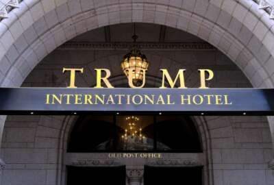 FILE- This March 11, 2019 file photo, shows the north entrance of the Trump International in Washington.  A federal appeals court in Washington on Friday dismissed a lawsuit filed by members of Congress that charged that President Donald Trump has illegally profited off the presidency.  (AP Photo/Mark Tenally, File)