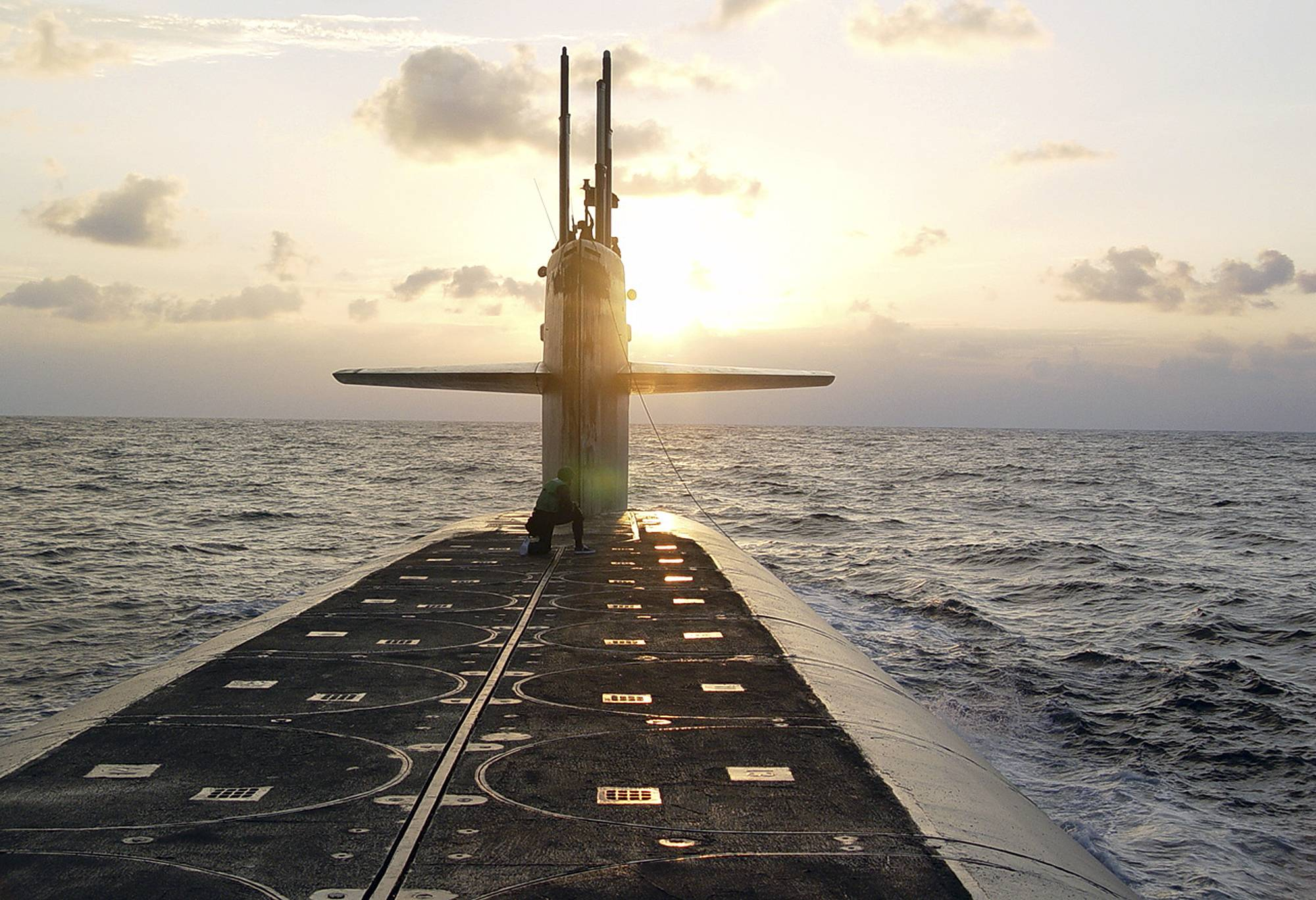 FILE - In this Jan. 9, 2008 photo released by the U.S. Navy, The Ohio-class ballistic-missile submarine USS Wyoming approaches Naval Submarine Base Kings Bay, Ga. The Pentagon's top policy official tells The Associated Press that the United States for the first time has deployed the newest addition to its nuclear arsenal — a submarine-launched weapon that the Trump administration says will make nuclear war less likely.  (Lt. Rebecca Rebarich/U.S. Navy via AP)