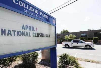 In this Tuesday, March 24, 2020 photo, a sign at a middle school in Orlando, Fla., reminds residents that April First is census day. The coronavirus has waylaid efforts to get as many people as possible to take part in the census. (AP Photo/John Raoux)