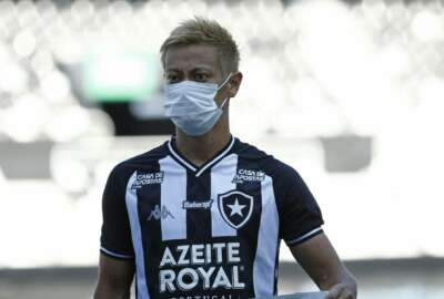 Japan's Keisuke Honda of Brazil's Botafogo wears a mask before a Carioca Championship soccer match against Bangu in Rio de Janeiro, Brazil, Sunday, March 15, 2020. The match was played in an empty, closed door stadium to contain transmission of the new coronavirus. (AP Photo/Bruna Prado)