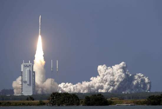 A United Launch Alliance Atlas V rocket lifts off from launch complex 41 at the Cape Canaveral Air Force Station with a payload of a high frequency satellite Thursday, March 26, 2020, in Cape Canaveral, Fla. Built by Lockheed Martin, this U.S. military spacecraft will provide highly-secure communications. (AP Photo/John Raoux)