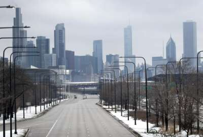 Chicago's Lake Shore Drive is barren of its usual vehicle traffic, Monday, March 23, 2020. The coronavirus pandemic could test a generation in ways they have never faced. One expert likens the impact to that of the Great Depression. As they're being asked to study at home and distance socially to help their more vulnerable elders, how will they cope? (AP Photo/Charles Rex Arbogast)