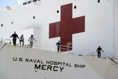 The USNS Mercy hospital ship sits at dock before its departure Monday, March 23, 2020, in San Diego. The Navy hospital ship was preparing to leave San Diego on Tuesday and planned to spend a few days at sea getting its newly formed medical team used to working together before arriving to Los Angeles to help the city free up its hospital beds, in efforts to help combat the coronavirus. (AP Photo/Gregory Bull)