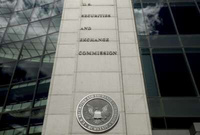 FILE - In this Aug. 5, 2017, file photo U.S. Securities and Exchange Commission building in Washington. Securities and Exchange Commission employees have been told to work remotely for the foreseeable future after a coronavirus scare at the agency's Washington headquarters. The agency, said it was informed Monday, March 9, 2020, that a headquarters employee had received medical treatment for respiratory symptoms earlier in the day. (AP Andrew Harnik, File)