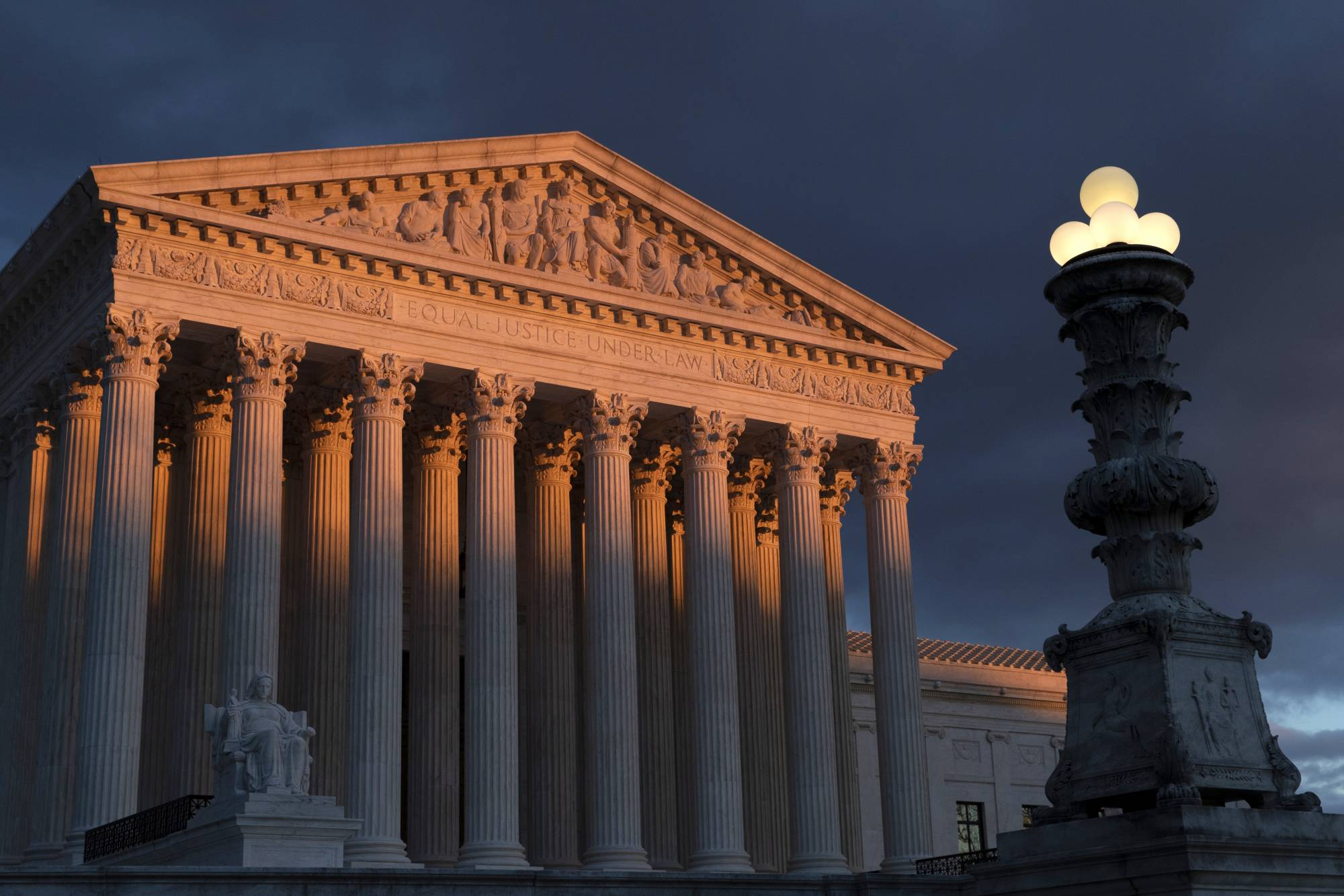 "FILE - In this Jan. 24, 2019 file photo, the Supreme Court is seen at sunset in Washington. The Supreme Court has ruled that insurance companies can collect $12 billion from the federal government to cover their losses in the early years of the health care law championed by President Barack Obama. The justices voted 8-1 Monday in holding that insurers are entitled to the money under a provision of the ""Obamacare"" health law that promised the companies a financial cushion for losses they might incur by selling coverage to people in the marketplaces created by the health care law. (AP Photo/J. Scott Applewhite)"