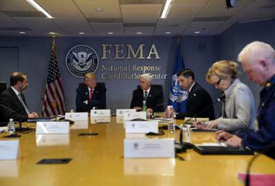 FILE - In this March 19, 2020, file photo, President Donald Trump attends a teleconference with governors at the Federal Emergency Management Agency headquarters, Thursday, March 19, 2020, in Washington. From left, Department of Health and Human Services Secretary Alex Azar, Trump, Vice President Mike Pence, Acting Secretary of Homeland Security Chad Wolf, White House coronavirus response coordinator Dr. Deborah Birx and Adm. Brett Giroir, assistant secretary for health. There's the standard process for getting urgently needed coronavirus equipment: send a request to FEMA. Then there's the other way: have a buddy who can pick up the phone and call the Trump White House. Trump's team has proudly recounted instances where a call to the White House has produced fast results for those who have an in with the president.  (AP Photo/Evan Vucci, Poolm, File)