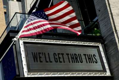 In this April 6, 2020 photo, a sign at The Anthem music venue reads