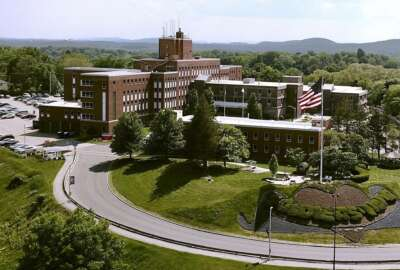 FILE - This May 2018 file photo ,shows an aerial view of the Holyoke Soldiers' Home in Holyoke, Mass. Nearly 70 residents have died from the coronavirus at the central Massachusetts home for aging veterans, as state and federal officials try to figure out what went wrong in the deadliest outbreak at a long-term care facility in the U.S. (Patrick Johnson/The Republican via AP, File)