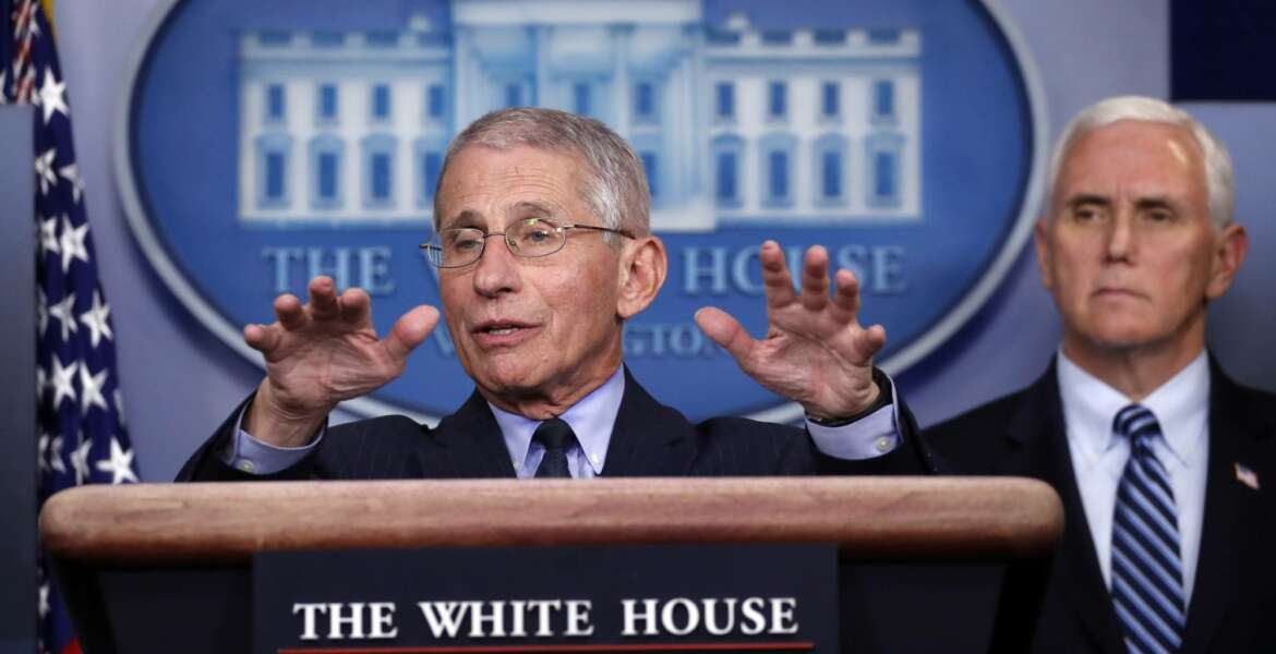 Dr. Anthony Fauci, director of the National Institute of Allergy and Infectious Diseases, speaks about the coronavirus in the James Brady Press Briefing Room of the White House, Wednesday, April 1, 2020, in Washington, as Vice President Mike Pence listens. (AP Photo/Alex Brandon)