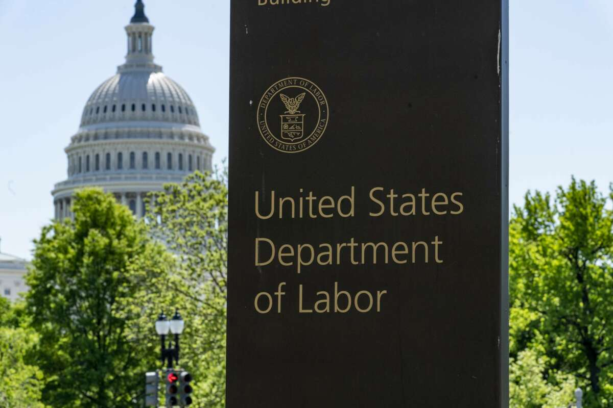 In this May 7, 2020, photo, the entrance to the Labor Department is seen near the Capitol in Washington. The record unemployment rate reflects a nation ravaged by the coronavirus pandemic, the economic devastation upending the presidential campaign and forcing President Donald Trump to overcome historic headwinds to win a second term.  (AP Photo/J. Scott Applewhite)