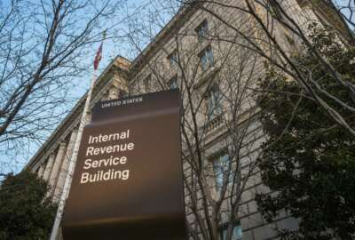 "FILE - This April 13, 2014, file photo shows the Internal Revenue Service (IRS) headquarters building in Washington. The Treasury Department and the IRS are urging taxpayers who want to get their economic impact payments directly deposited to their bank accounts to enter their information online by Wednesday, May 11, 2020. The IRS said that people should use the ""Get My Payment"" tool on the IRS website by noon on Wednesday to provide their direct deposit information. (AP Photo/J. David Ake, File)"