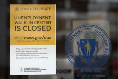 A sign announces the closure of the Massachusetts Unemployment Office, Saturday, May 9, 2020, in Boston. (AP Photo/Michael Dwyer)