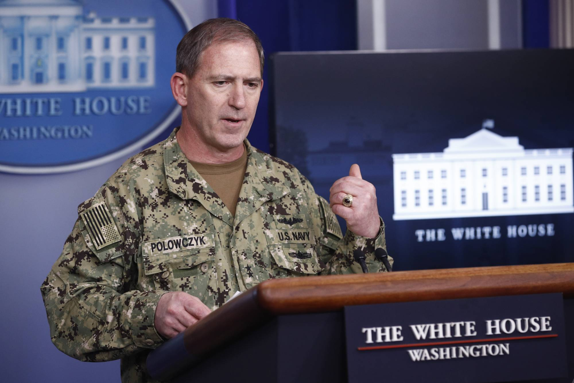FILE - In this April 5, 2020, file photo, Navy Rear Adm. John Polowczyk, supply chain task force lead at the Federal Emergency Management Agency, speaks during a coronavirus task force briefing at the White House in Washington. U.S. officials are invoking a rarely used provision of American law that would shield companies from antitrust regulations to help the country from again running out of medical supplies in a pandemic. Polowczyk, who was appointed to run a White House supply chain task force in response to the outbreak, told reporters last week that the government is expanding the emergency stockpile of critical supplies and medicines managed by the Department of Health and Human Services. (AP Photo/Patrick Semansky, File)