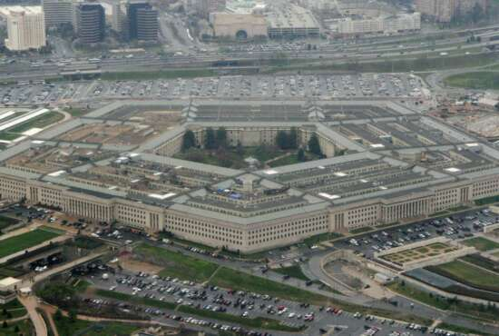 FILE - This March 27, 2008 file photo shows the Pentagon in Washington.  New Defense Department guidelines say that anyone who has been hospitalized for the coronavirus won't be allowed to enlist in the military unless they get a special medical waiver.  (AP Photo/Charles Dharapak, File)