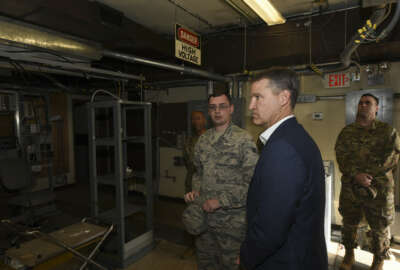 Bill Marion, Secretary of the Air Force deputy chief information officer, listens to a Tyndall Airman Dec. 18, 2018, about the work the 325th Communication Squadron's Airmen did to safeguard important equipment instrumental to the Radio Frequency transmissions infrastructure on Tyndall Air Force Base, Fla., in timeframes before and immediately after Hurricane Michael made landfall. Hurricane Michael was a Category 4 hurricane that made landfall Oct. 10, 2018, that caused near catastrophic damage to the Panama City area. (U.S. Air Force photo by Airman 1st Class Solomon Cook)