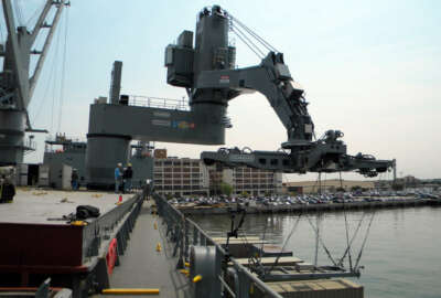 The Office of Naval Research tests their Large Vessel Interface Lift-on/Lift-off crane at Naval Station Norfolk. The demonstrator crane, which has been temporarily installed on the Maritime Administration ship SS Flickertail State, uses motion-sensing technology to control standard 20-foot containers in all six degrees of freedom.