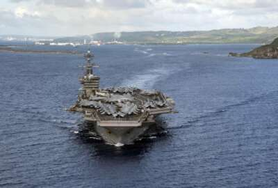 PHILIPPINE SEA (June 4, 2020) In this June 4, 2020, photo provided by the U.S. Navy, the aircraft carrier USS Theodore Roosevelt (CVN 71) departs Apra Harbor in Guam. The carrier has returned to sea and is conducting military operations in the Pacific region, 10 weeks after a massive coronavirus outbreak sidelined Navy warship. (Mass Communication Specialist Seaman Kaylianna Genier/U.S. Navy via AP)