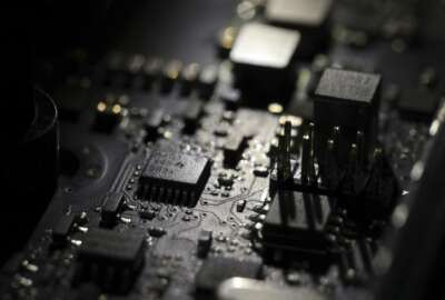 FILE - This Feb 23, 2019, file photo shows the inside of a computer in Jersey City, N.J. Foreign hackers are taking advantage of the coronavirus pandemic to undermine institutions and threaten critical infrastructure, a top U.S. military cyber official said Thursday, June 25, 2020. (AP Photo/Jenny Kane, File)
