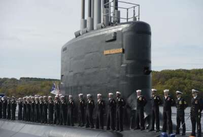 FILE - This Oct. 29, 2016 file photo shows the commissioning of the attack submarine USS Illinois as sailors stand atop the sub in Groton, Conn. For decades, the Navy's leading supplier of high-strength steel for submarines provided subpar metal because one of the company's longtime employees falsified lab results, putting sailors at greater risk in the event of collisions or other impacts, federal prosecutors said in court filings Monday, June 15, 2020. The supplier, Kansas City-based Bradken Inc., paid $10.9 million as part of a deferred prosecution agreement, the Justice Department said. The company provides steel castings that Navy contractors Electric Boat and Newport News Shipbuilding use to make submarine hulls. The government did not disclose which subs were affected. (AP Photo/Jessica Hill, File)