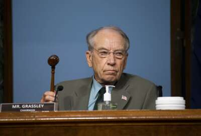 Chairman Chuck Grassley, R-Iowa, holds up a gavel during a Senate Finance Committee hearing on