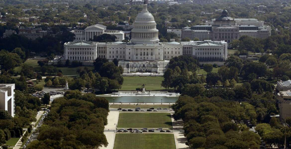 FILE - This Sept. 18, 2019, file photo shows the view of the U.S. Capitol building from the Washington Monument in Washington. The federal government incurred the biggest monthly budget deficit in history in June 2020 as spending on programs to combat the coronavirus recession exploded while millions of job losses cut into tax revenues. The Treasury Department reported Monday, July 13, 2020 that the deficit hit $864 billion last month, an amount of red ink that surpasses most annual deficits in the nation's history and is above the previous monthly deficit record of $738 billion in April.(AP Photo/Patrick Semansky, File)