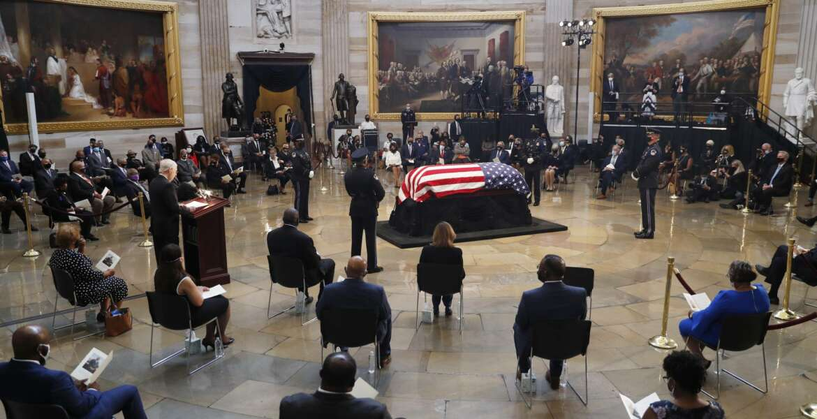 Senate Majority Leader Mitch McConnell of Ky., speaks during a memorial service as the flag-draped casket of Rep. John Lewis, D-Ga., lies in state at the Capitol Rotunda, Monday, July 27, 2020, in Washington.  (Shawn Thew/Pool via AP)